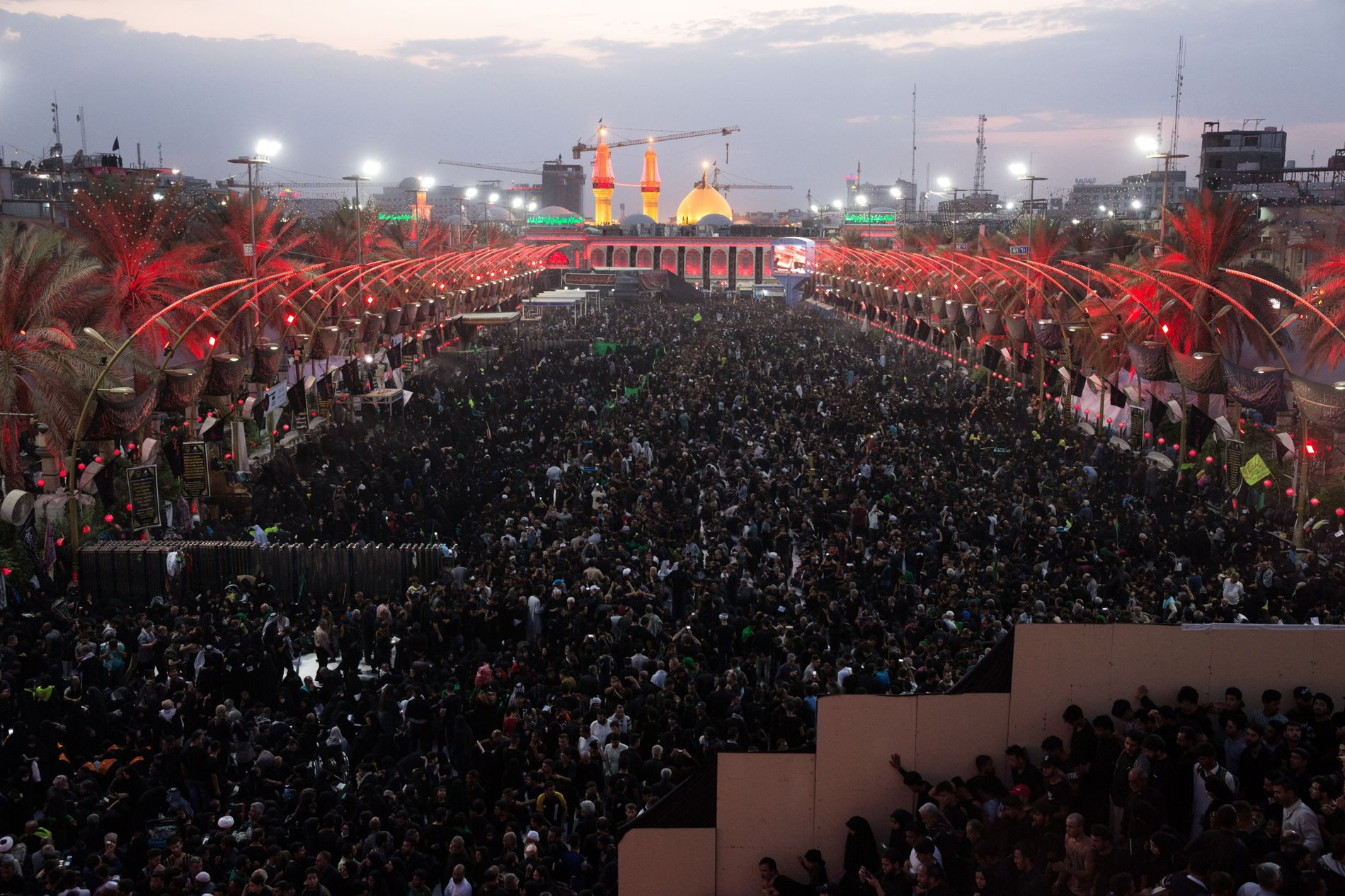 Prayer time between the Imam Husayn shrine and the Imam Abbas Shrine sees thousands fill the ...