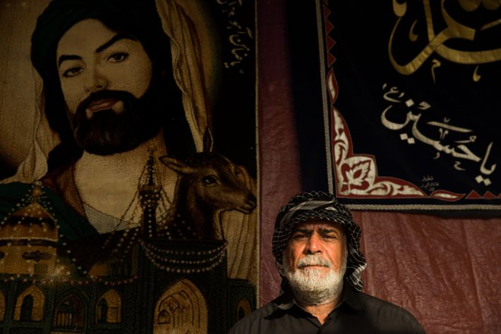 Portrait of a pilgrim on the road from Basra, Imam Husayn woven into a carpet behind ...