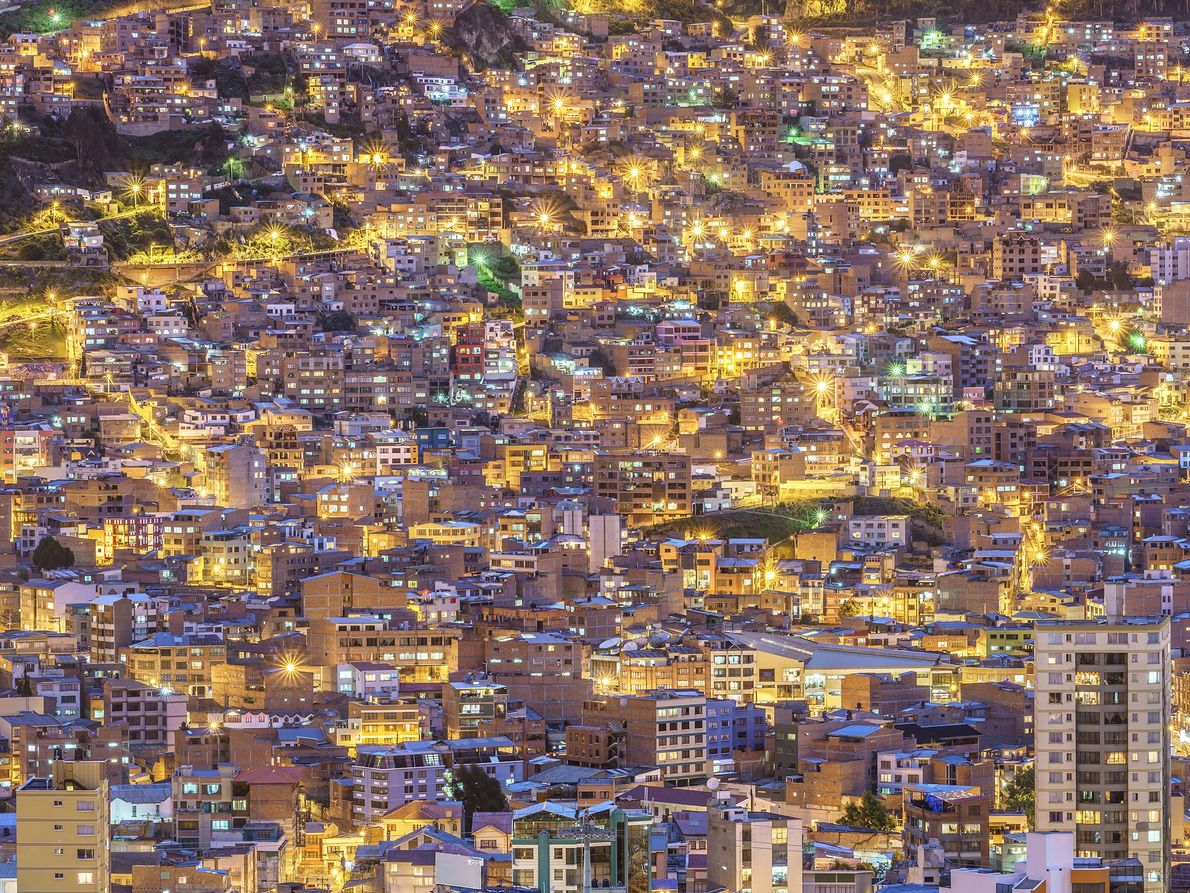 Dusk of La Paz. A city was dyed blue, and there was golden street light. That ...