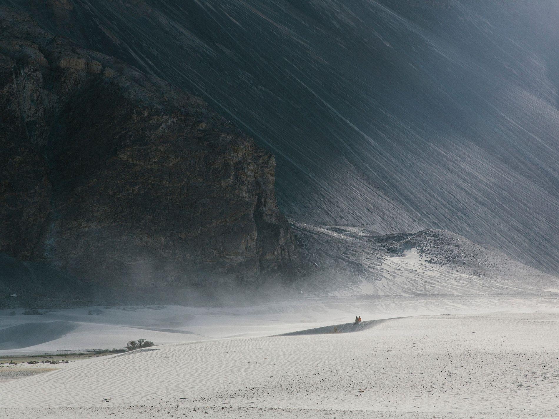 A couple soaks up the otherworldly landscape of Ladakh, India.