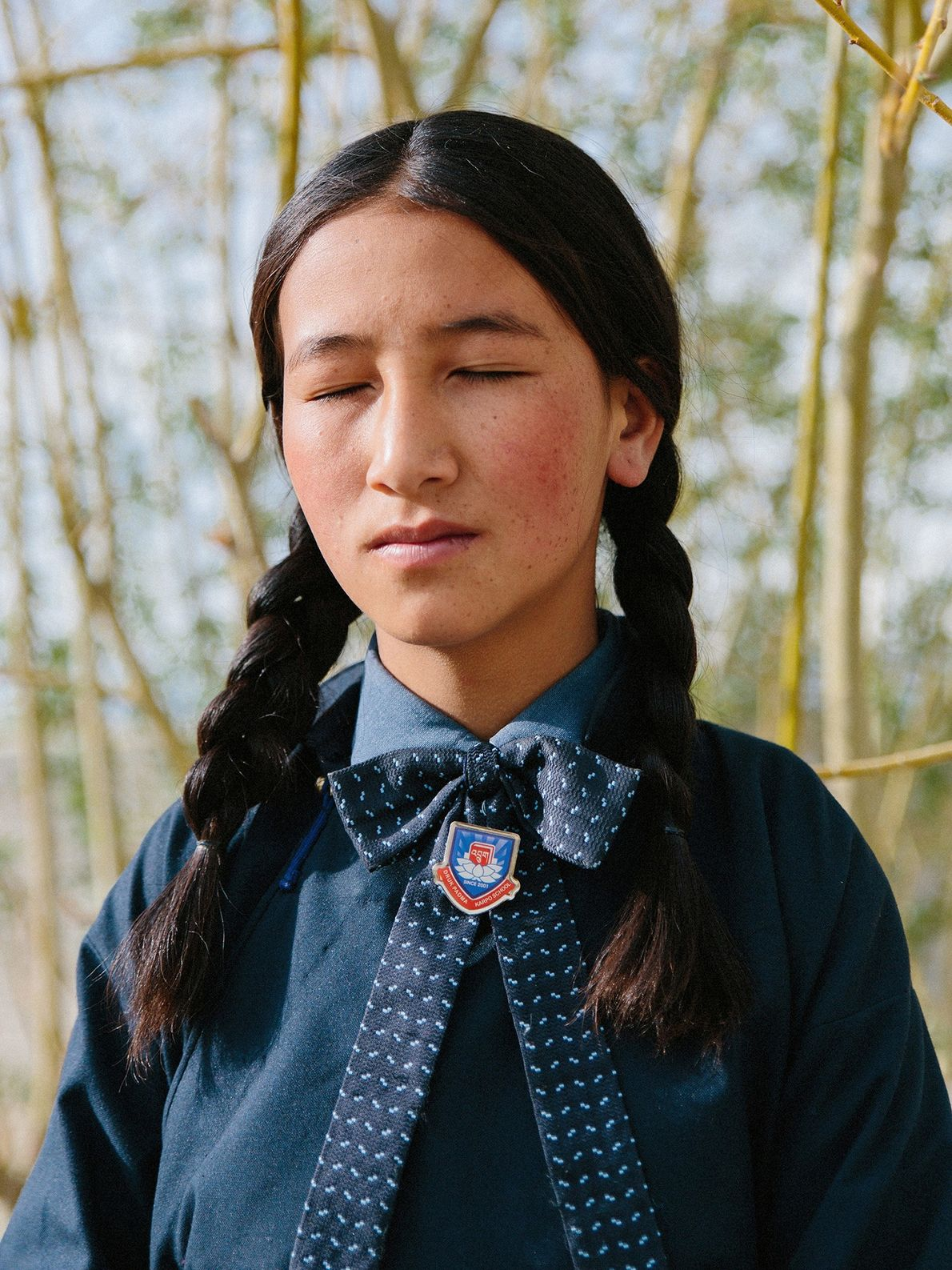 A young student meditates at Druk White Lotus School. In Ladakh, children meditate from a young ...