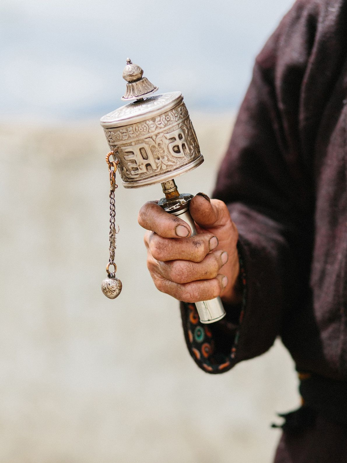 Tibetan prayer wheels, called mani wheels, are believed to spread spiritual blessings and well-being.
