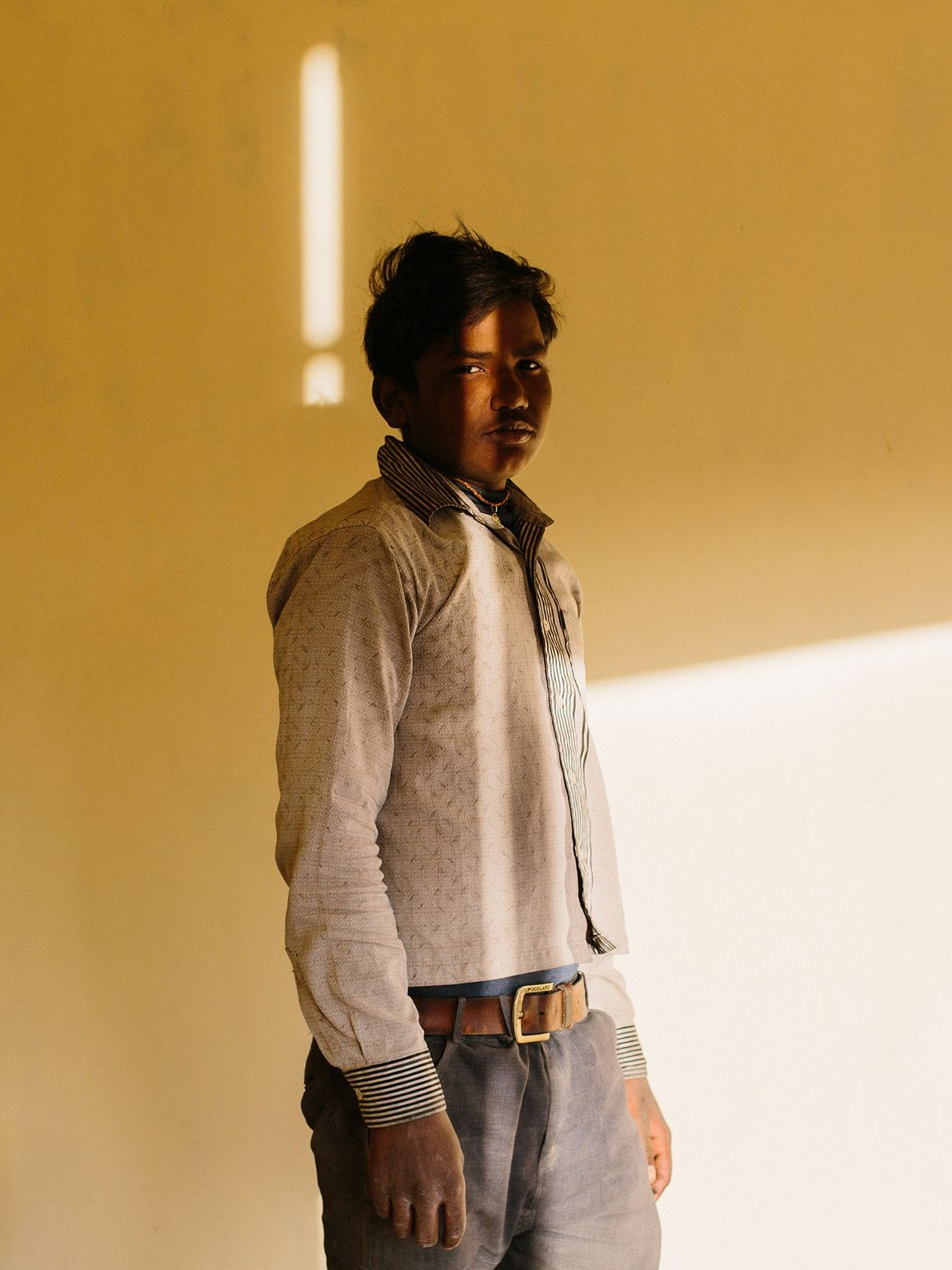 A migrant worker from Bihar, India poses for a portrait.