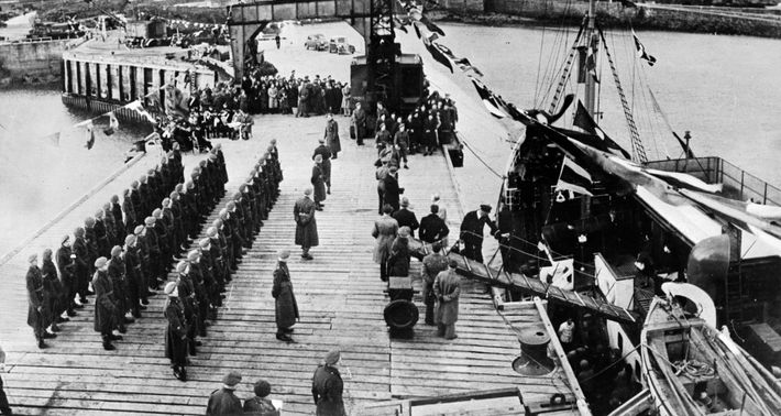 Alderney's residents, evacuated during the war, are welcomed back to the island by British troops in ...