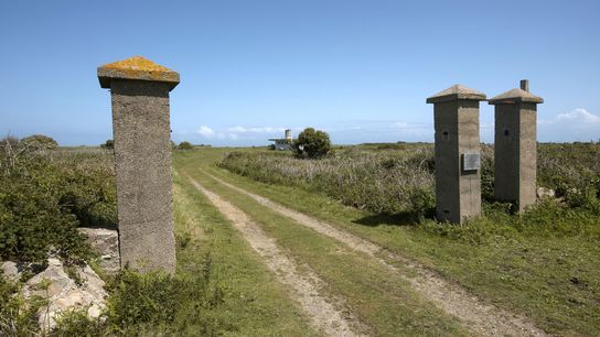 The entrance gates to the Nazi concentration camp Sylt are among the few visible remains left ...