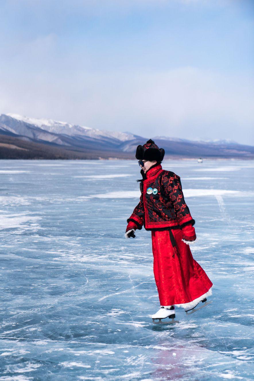 A reveler skates on the ancient lake.