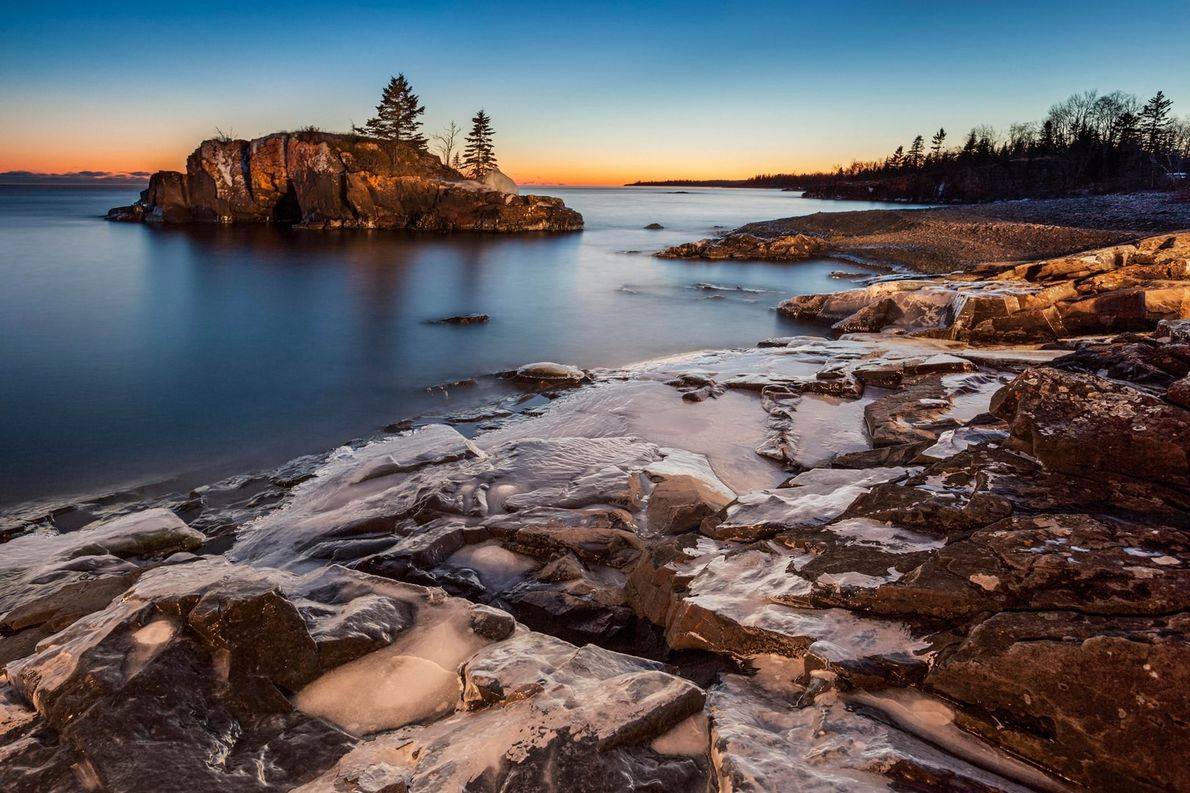 Train travellers can enjoy Canada's breathtaking views. Photo of Lake Superior at dusk, Thunder Bay, Ontario.