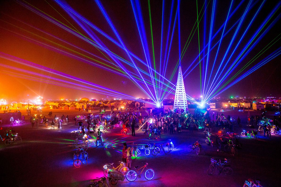 The desert comes alive with strobe lights and glowing bicycles, and often many dance parties compete ...