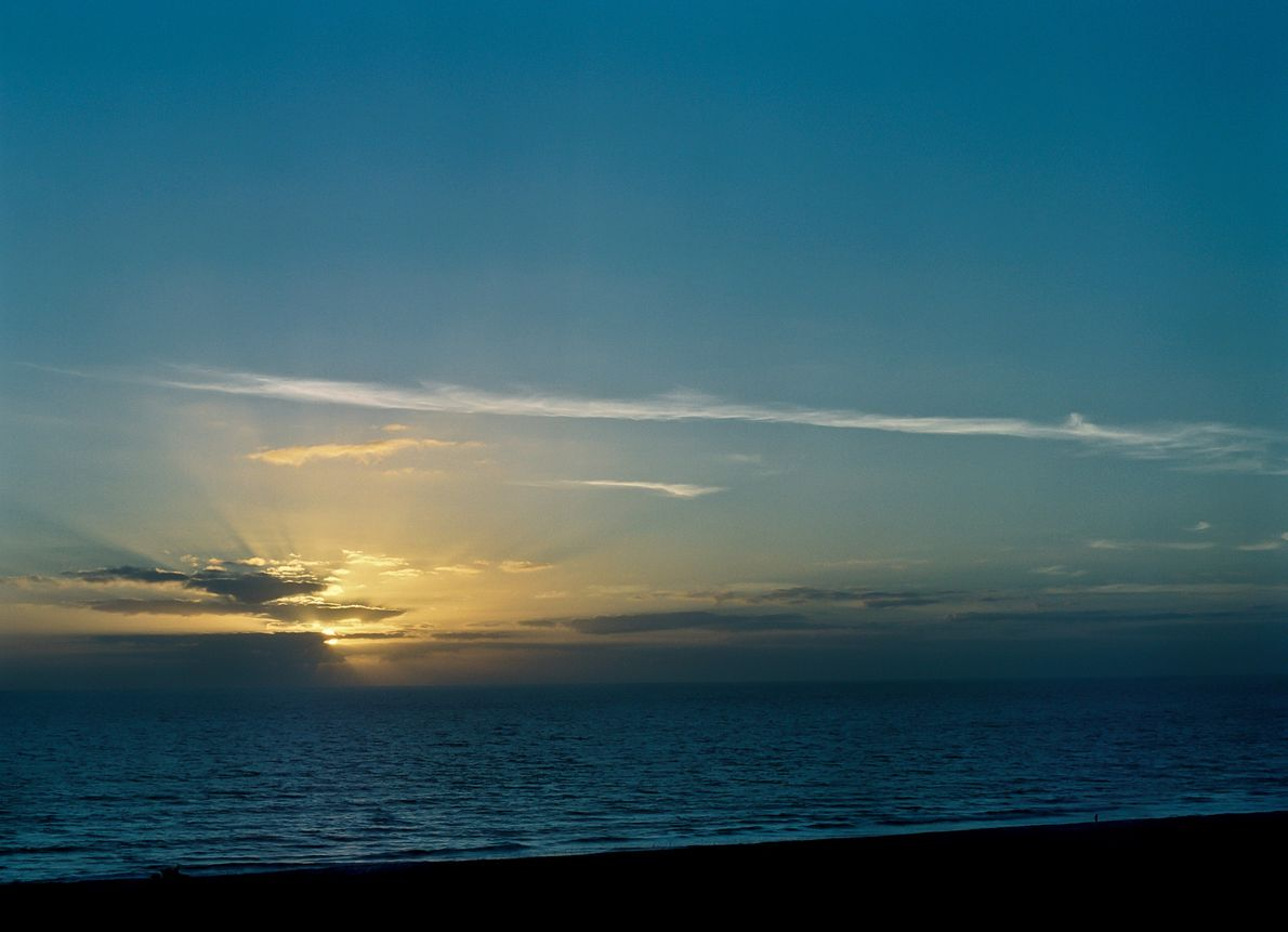 The sun rises expectantly over Cocoa Beach, Florida, on January 19, 2006—hours before New Horizons launched ...