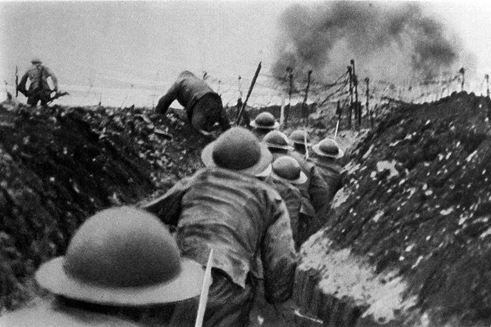 English soldiers race out of their trench during the Battle of the Somme in France, 1916. ...