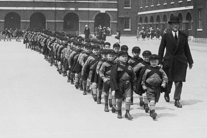 In 1926 resident boys walk around the grounds of the Foundling Hospital, originally called the Hospital ...