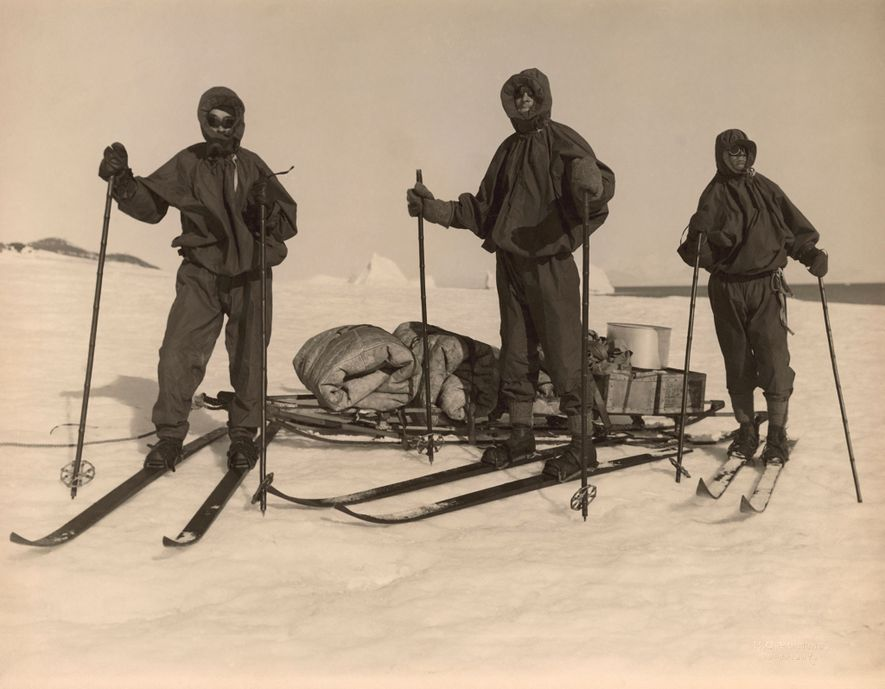 Members of a British expedition team pause for a photograph while skiing through Antarctica. The group, ...