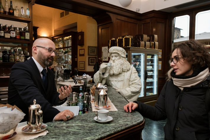 At Florence's Café Rivoire, Conti sips an espresso while resting his feet. His costume is modeled ...