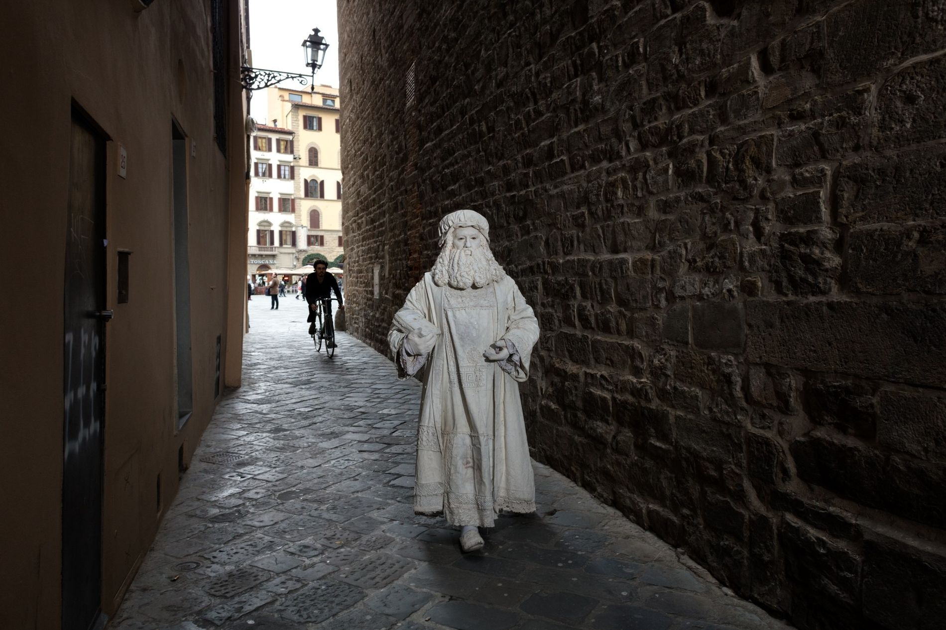 Valter Conti, strolling through one of Florence's narrow alleyways, began posing as Leonardo da Vinci in 1990. He enjoys the silent anonymity of working as an impersonator.