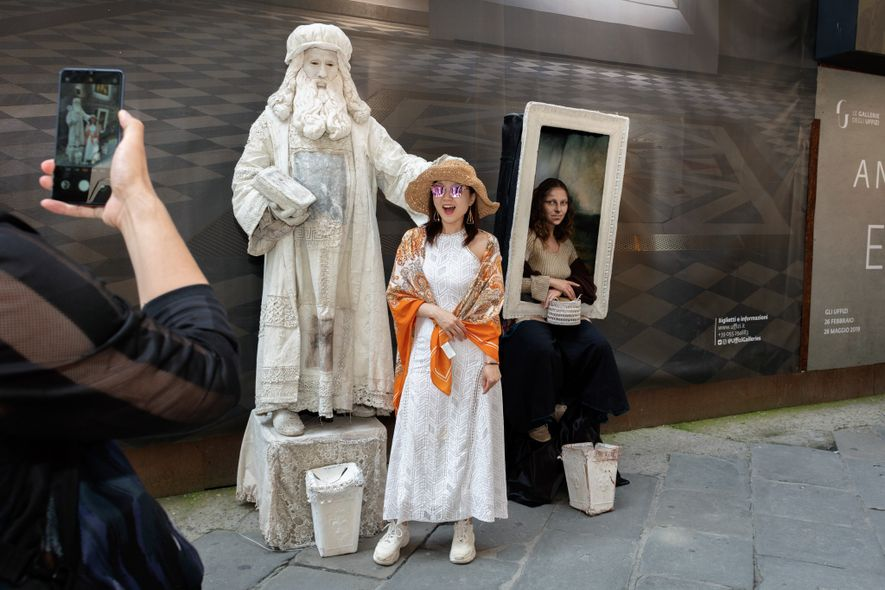 Conti and Pinori pose for countless souvenir photos with enamored tourists outside the Uffizi Gallery. The ...
