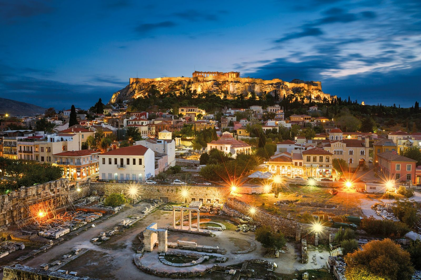 As night falls on Athens, the remains of Hadrian's monuments—including the magnificent library (center) destroyed in ...