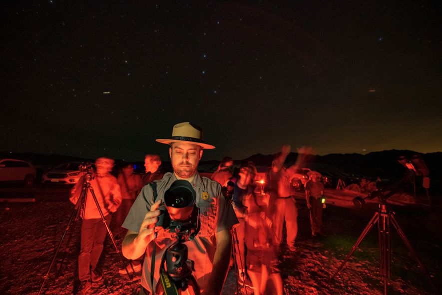 Park ranger and chief of education Patrick Taylor leads a night sky photography session inside the ...