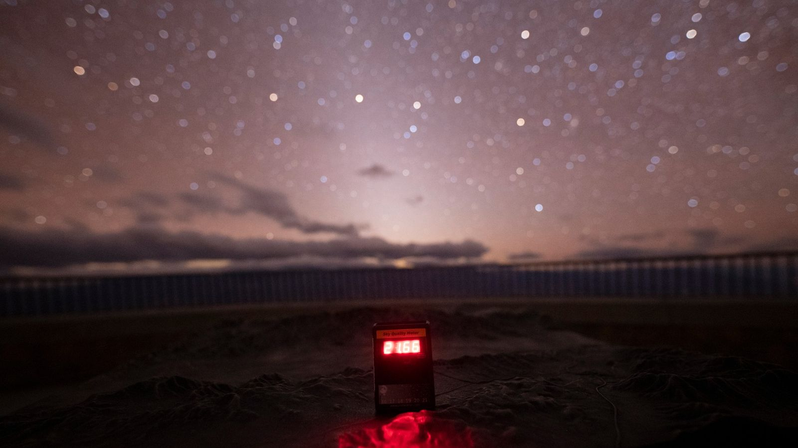 A Sky Quality Meter sitting in Death Valley reads the night sky brightness. In this case, ...