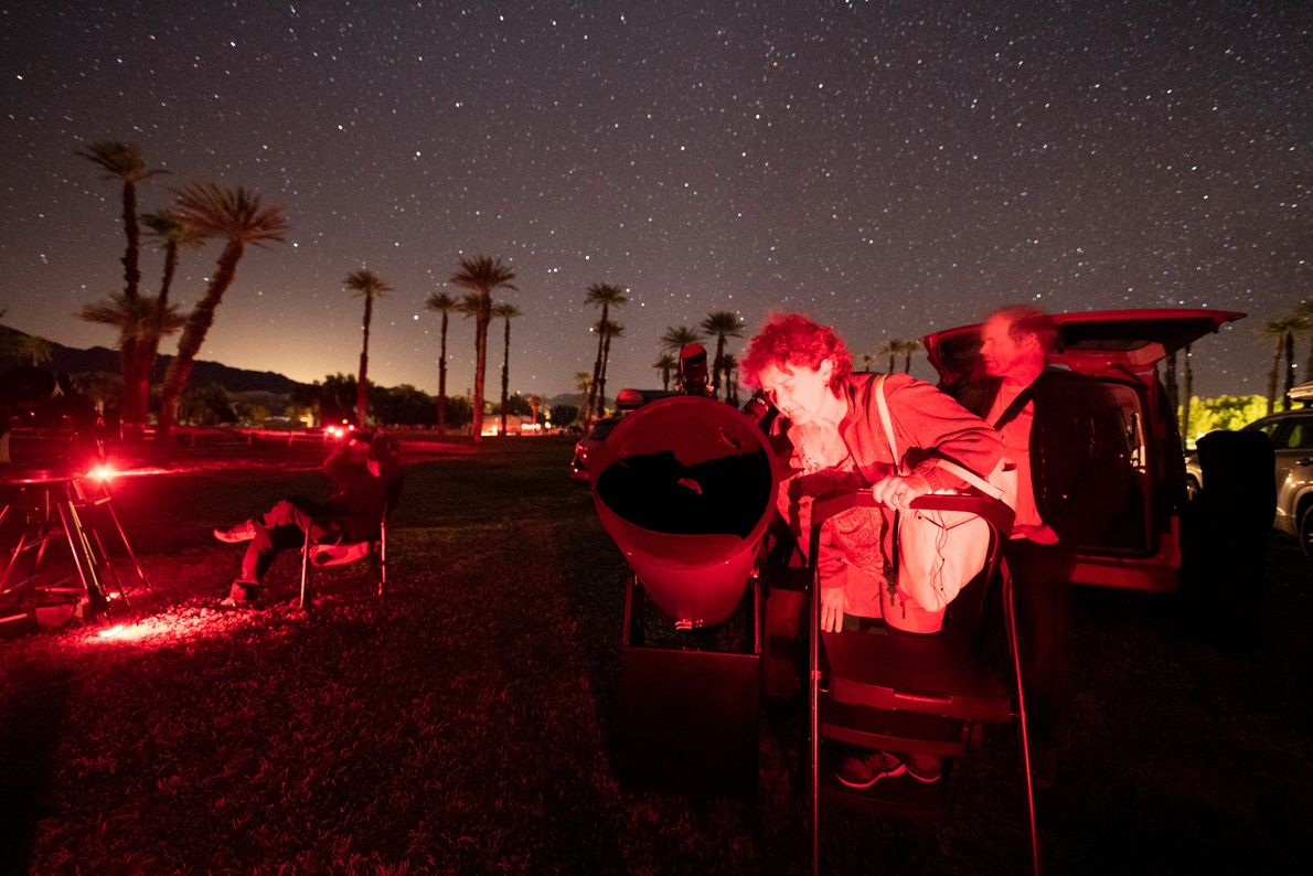 Photographer Babak Tafreshi stands under the star-filled Death Valley sky. The glow of city lights from ...