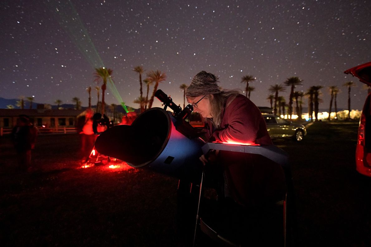 Cheryl Wilcox of the Riverside Astronomical Society points her telescope into the star fields twinkling above ...