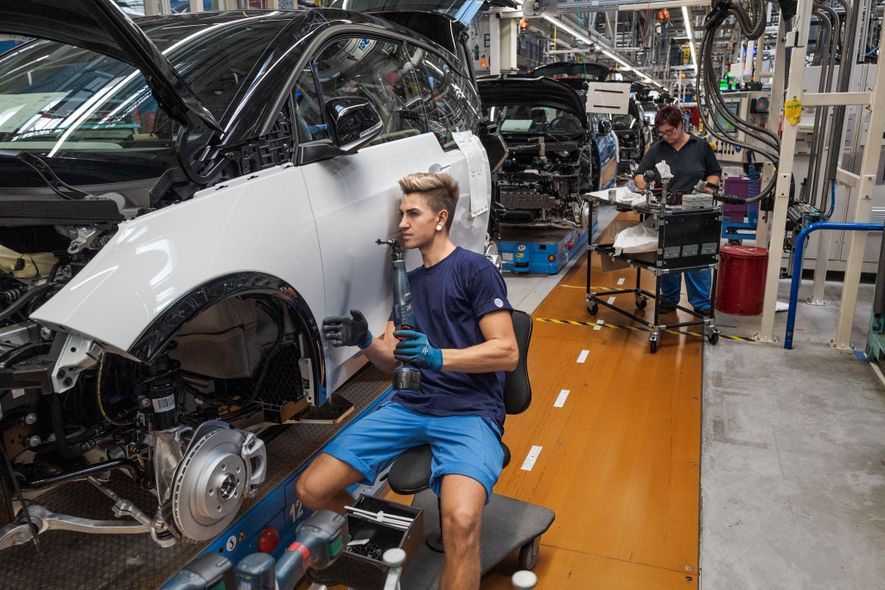 At a BMW plant in Leipzig, Germany, Marcus Hänsel checks the alignment on the door of ...