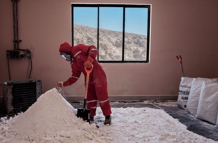 At the pilot plant, a worker checks lithium carbonate to see if it's dry, the final ...