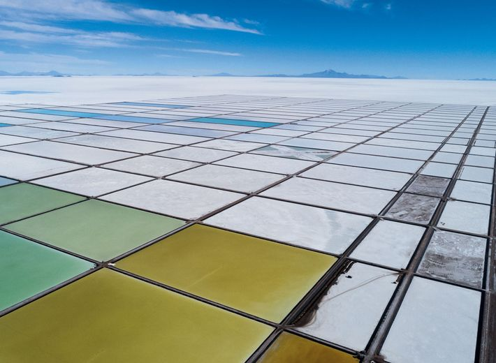 Evaporation pools carved out of the Salar de Uyuni create a colorful mosaic at the Llipi ...
