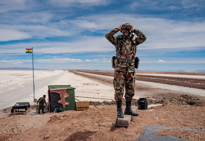 A soldier keeps a lookout at an observation post that guards the entrance to the lithium ...