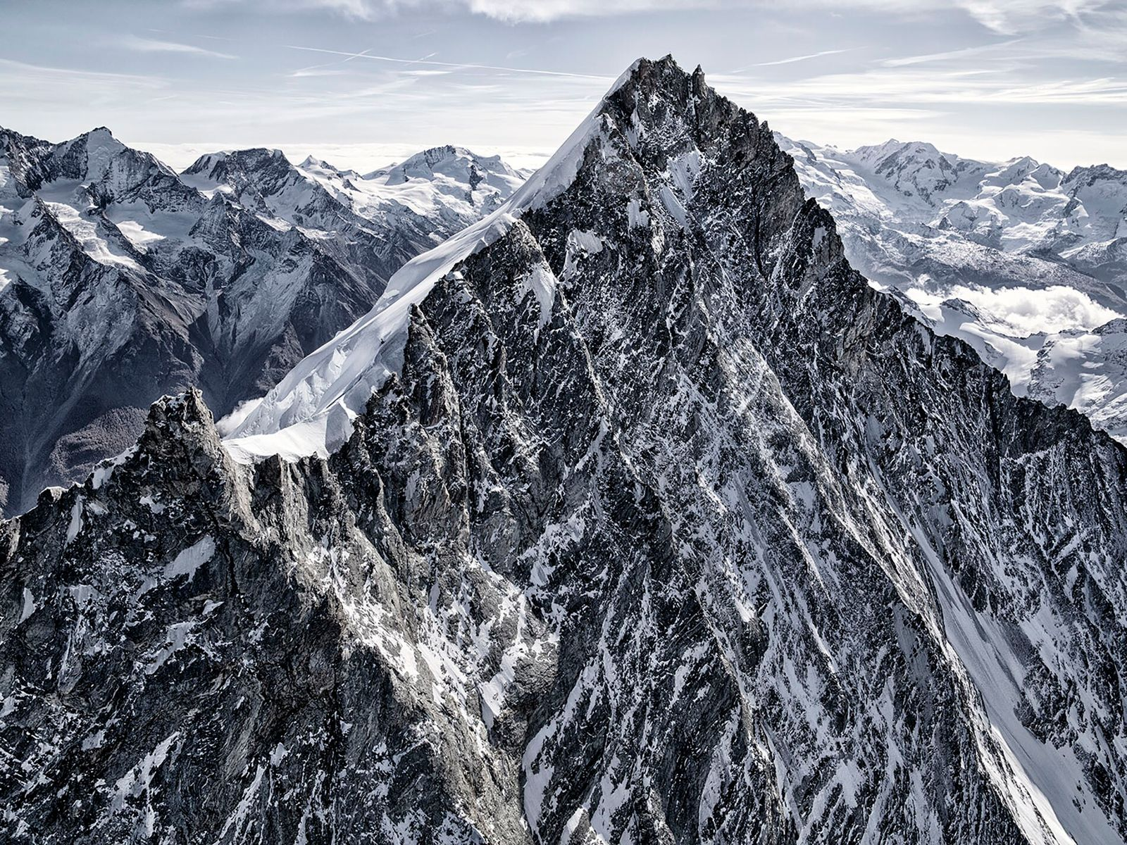 The Weisshorn in Zermatt is over 14,000ft high, looming over the Swiss landscape. Nico hung precariously ...