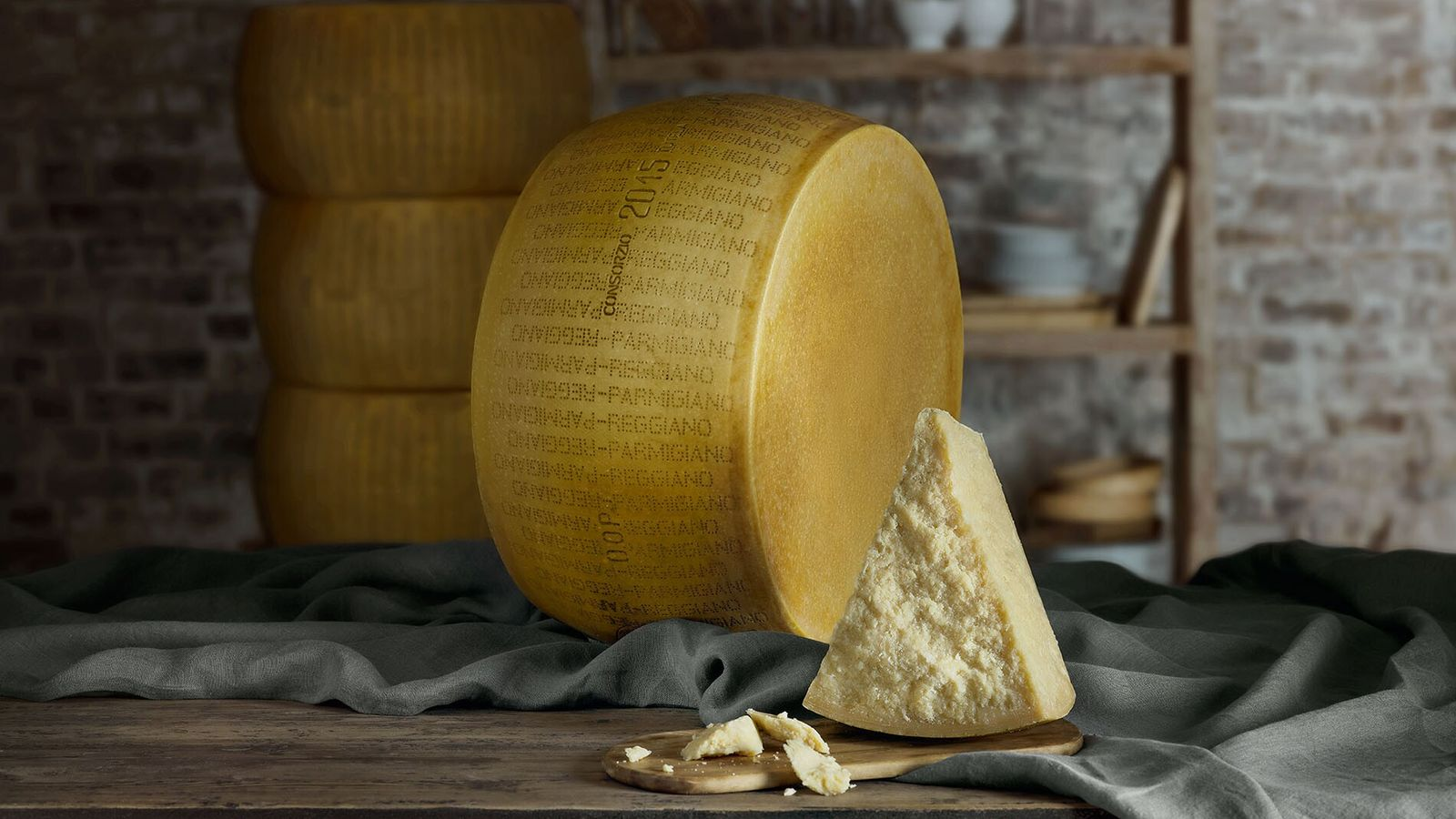 Each wheel of Parmigiano Reggiano is stamped with a unique code; an identity card to ensure every ...