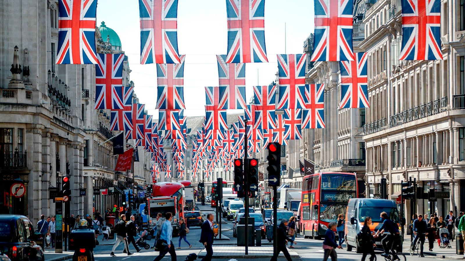 Union Jack flags decorate London's Regent Street ahead of the wedding of Prince Harry to American ...