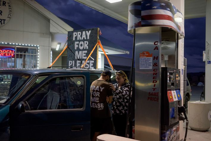 """John lives in his car topped with a sign that reads, """"pray for me please."""" He ..."""