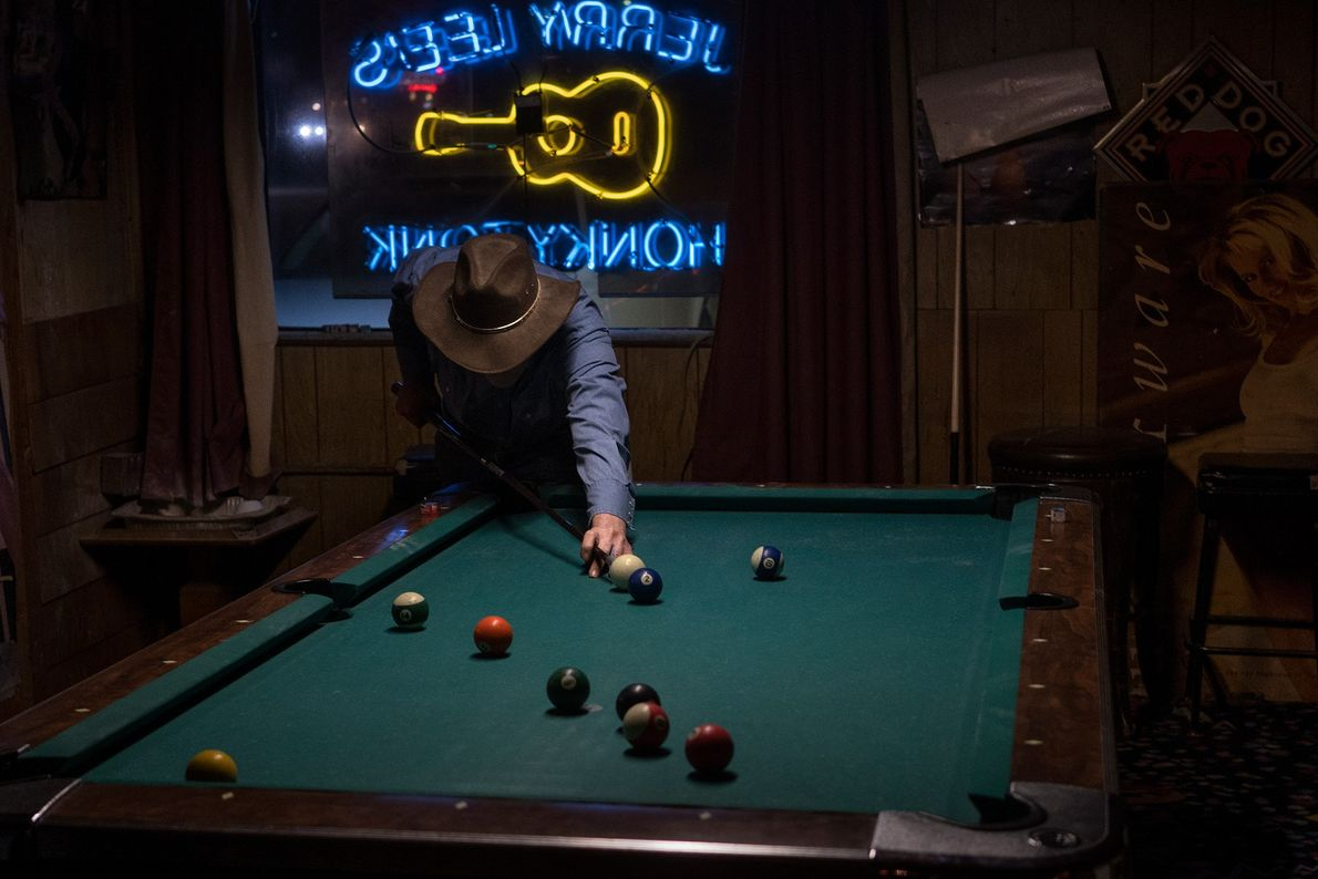 Lonny plays pool at Jerry Lee's Honky Tonk, a dive bar in Silver Spring.