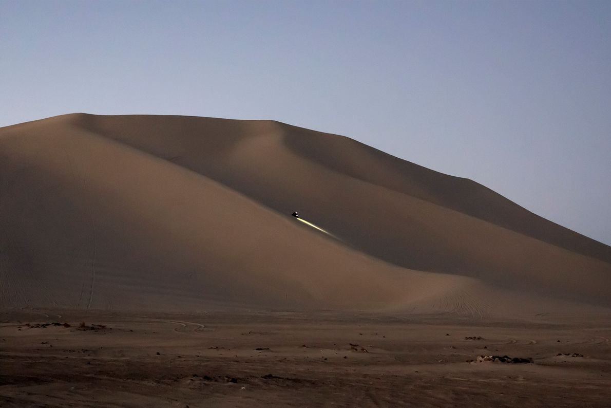 An off-highway vehicle rolls down Sand Mountain, a two-mile sand dune outside Fallon, Nevada.