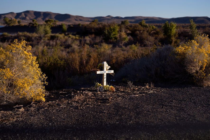 A lone, white cross marks the roadside between Fallon and Silver Springs, Nevada.
