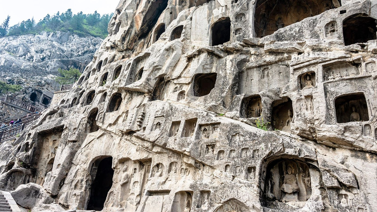 Cut into the Xiangshan and Longmen Shan hillsides above the Yi River, the Longmen complex is ...