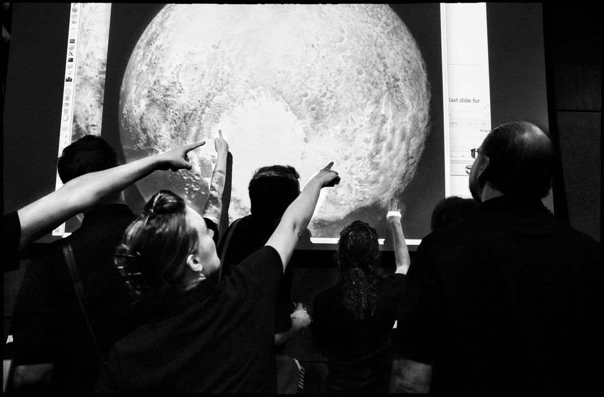 The New Horizons team pores over the spacecraft's final picture of Pluto before making its closest ...