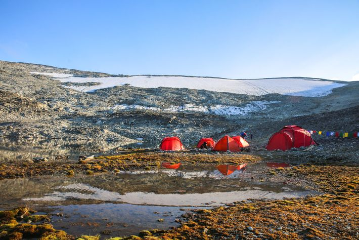 Archaeologists establish their basecamp in front of the Lendbreen ice patch in 2018.