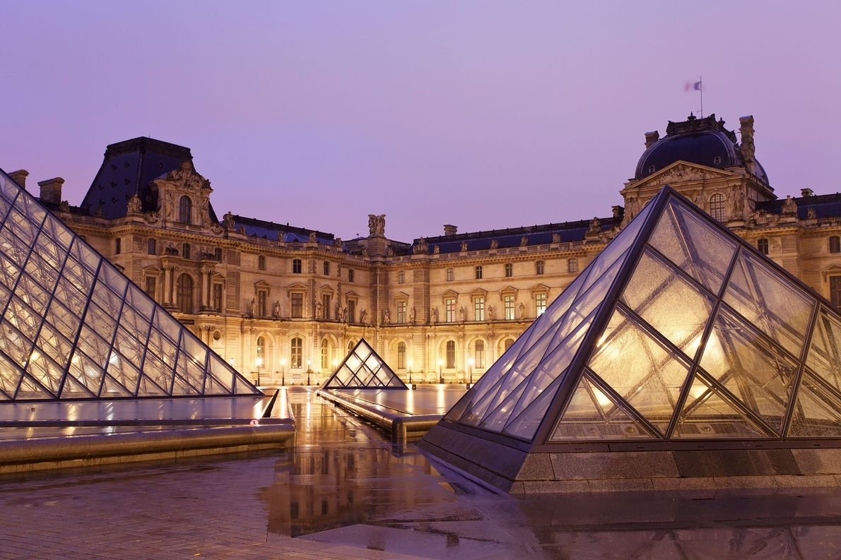 The Louvre's main entrance is illuminated at night. The world's biggest art museum, the Louvre was …