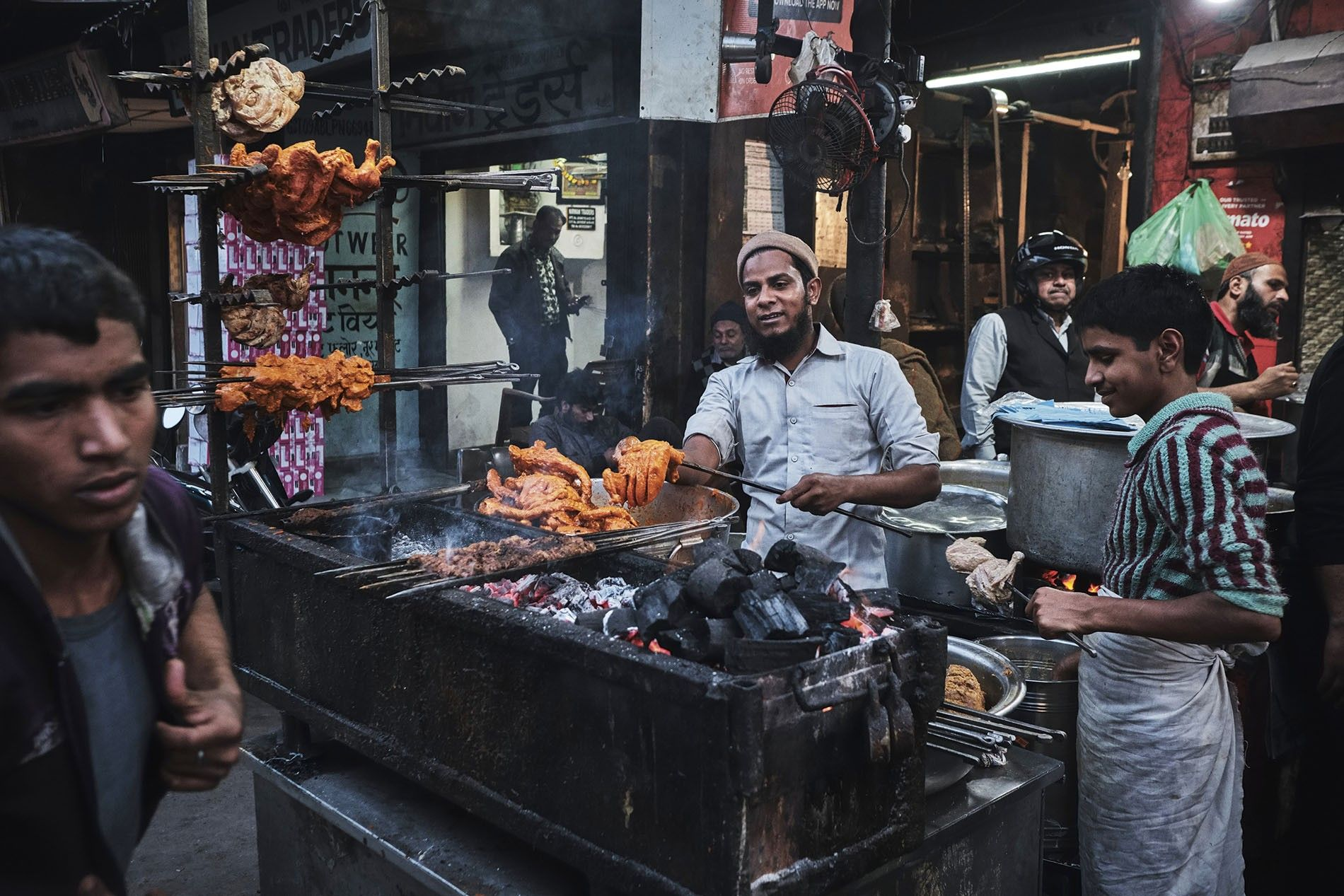 Pasanda kebabs on the grill while a cook skewers chicken at Raheem's in Chowk, Lucknow