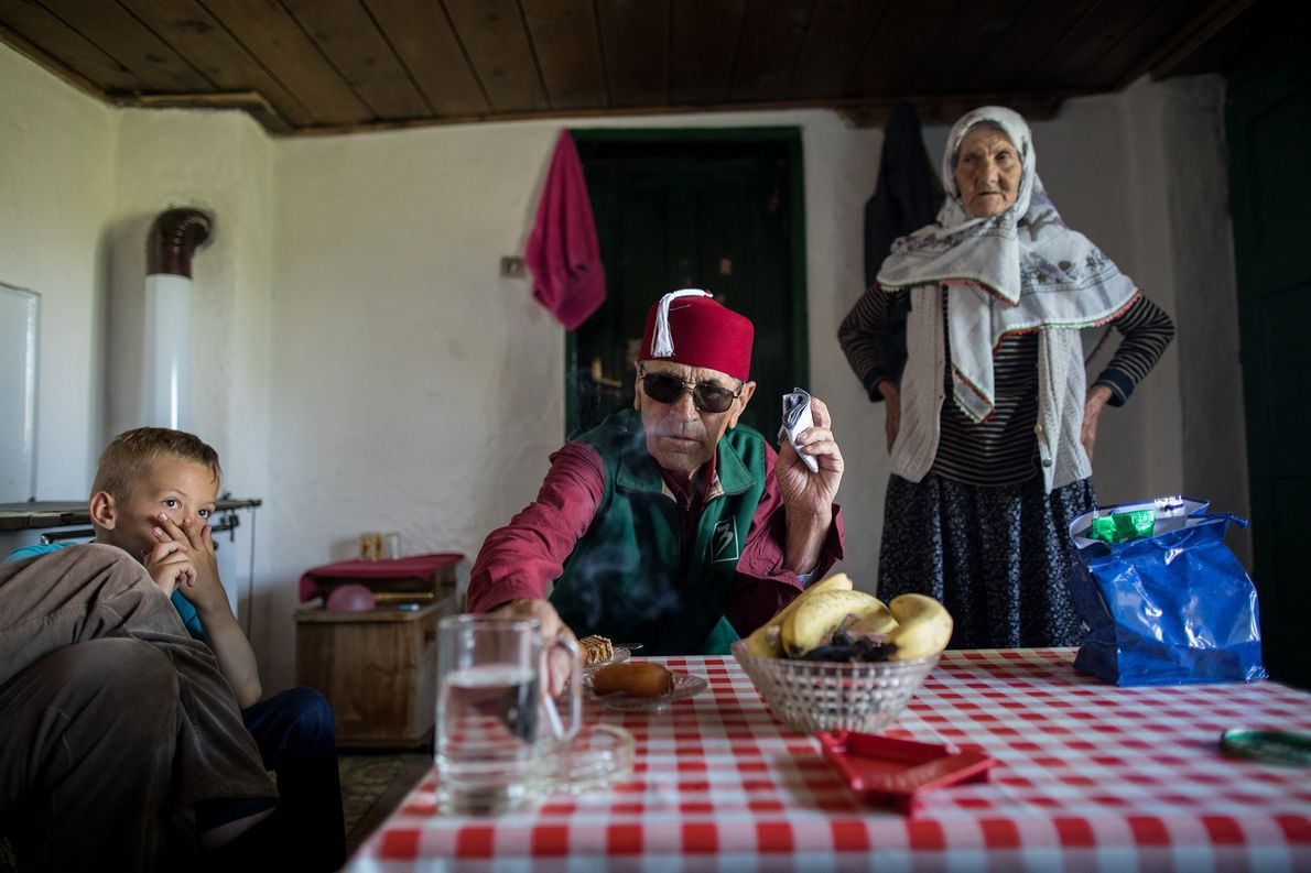 Villagers celebrate Eid Al-Adha with sweets inside a home in Lukomir.