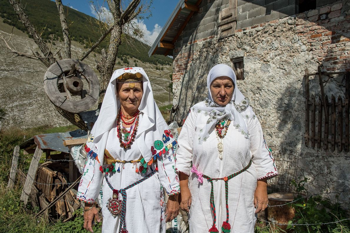 Women wear the traditional clothes of Lukomir for the annual celebration to finish preparing hay.