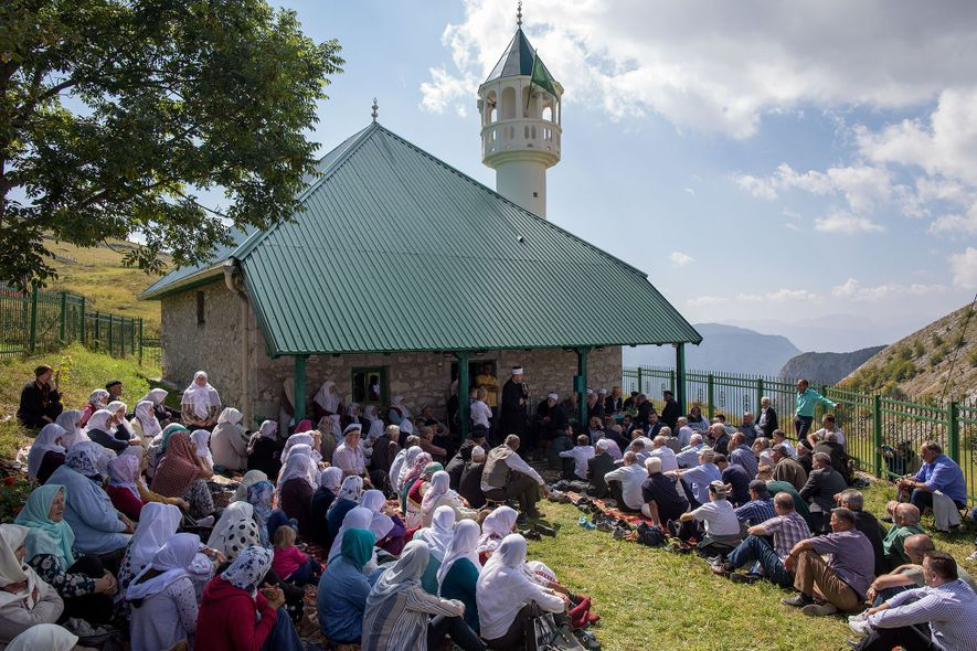 Villagers and guests gather in front of the village mosque as a part of an annual ...