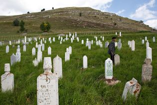 A man wanders the graveyard of Lukomir, where tombstones called stećci date from the 14th century.