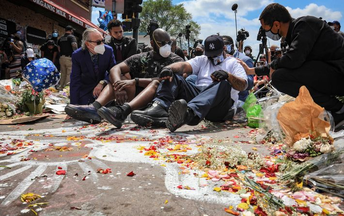 An emotional Terrence Floyd, second from right, is comforted as he sits on the spot at ...
