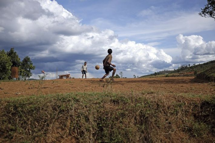 Merina boys playing on a makeshift football pitch on the edge of the village of Antsahabe, ...