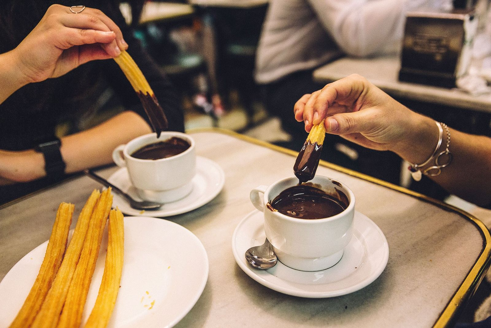 Chocolate and churros are the order of the day — or, rather, night — at Chocolatería San Ginés, ...