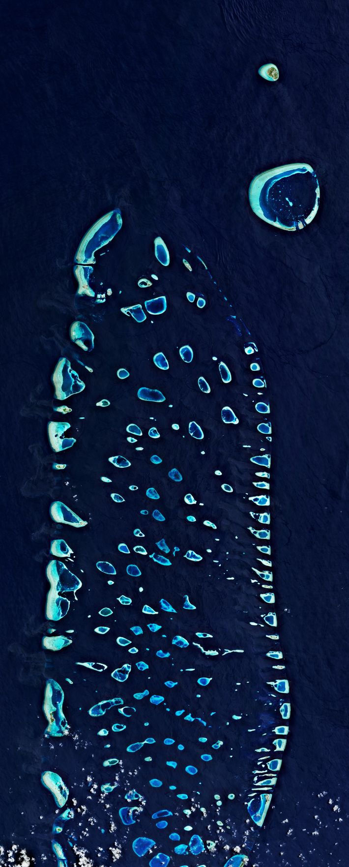 The Maldives, seen in part from above, is comprised of 1,192 islands. The tiny island nation ...