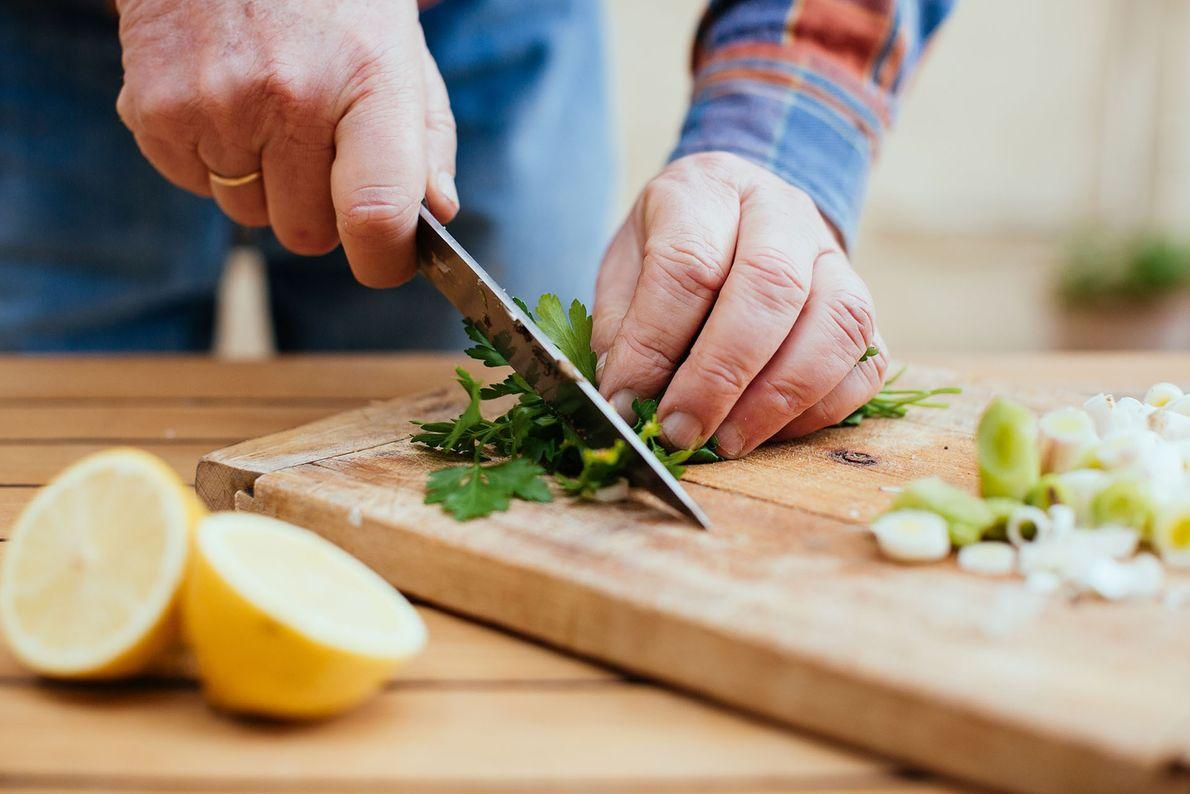 Julian chops fresh ingredients for dinner