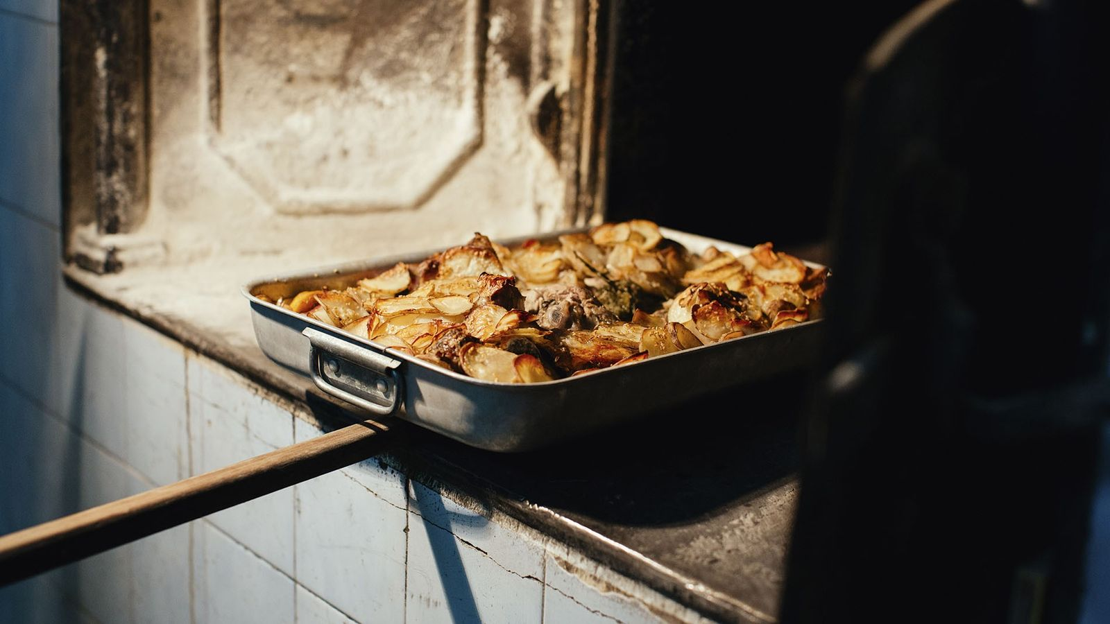 The family's lamb dish is cooked in the bakery oven